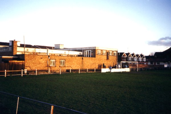 The clubhouse at the far end of the ground